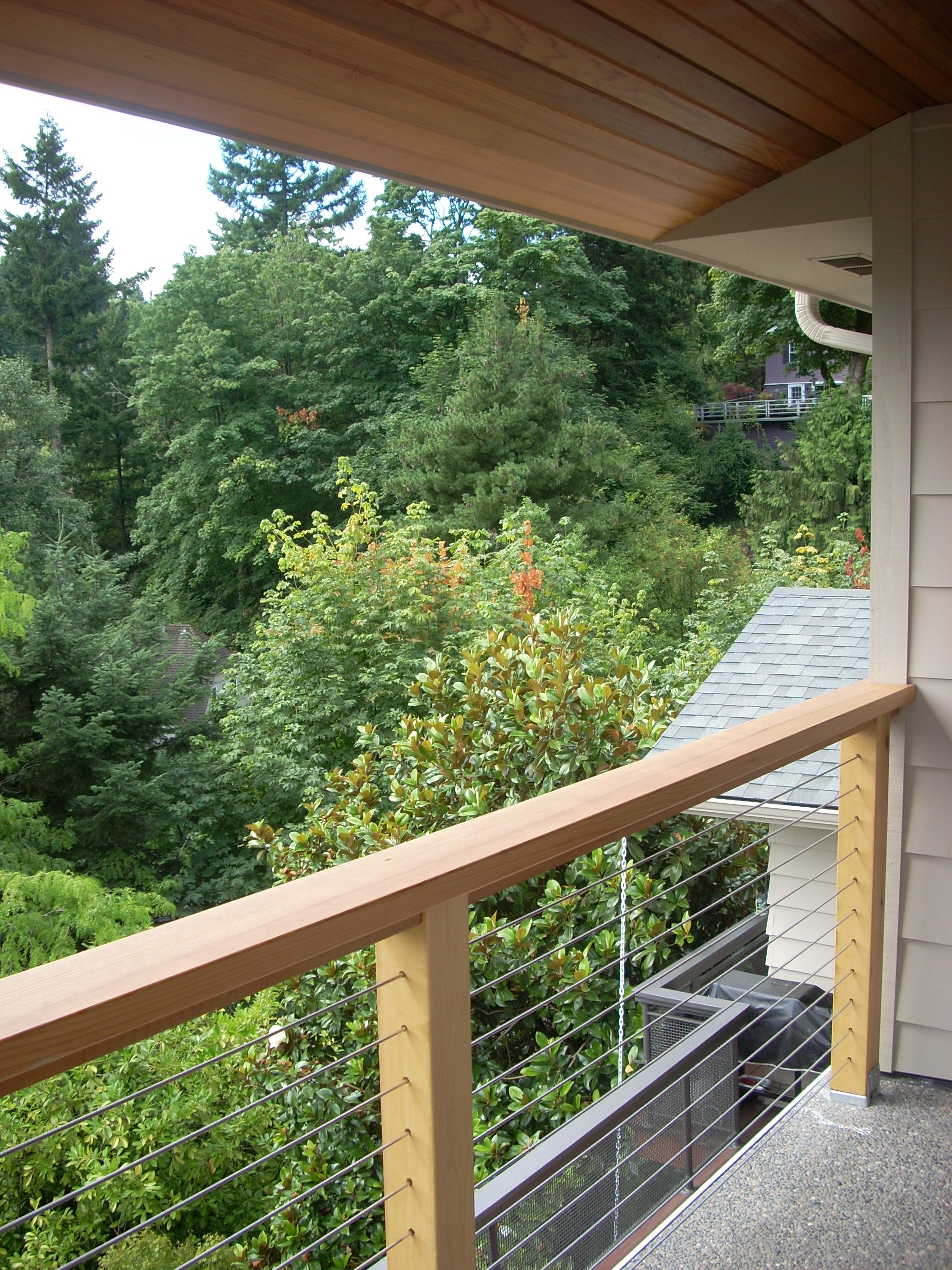 Adding a balcony to a house - A Balcony Facing A Wooded Area Has The Natural Advantages Of View And Privacy Combined