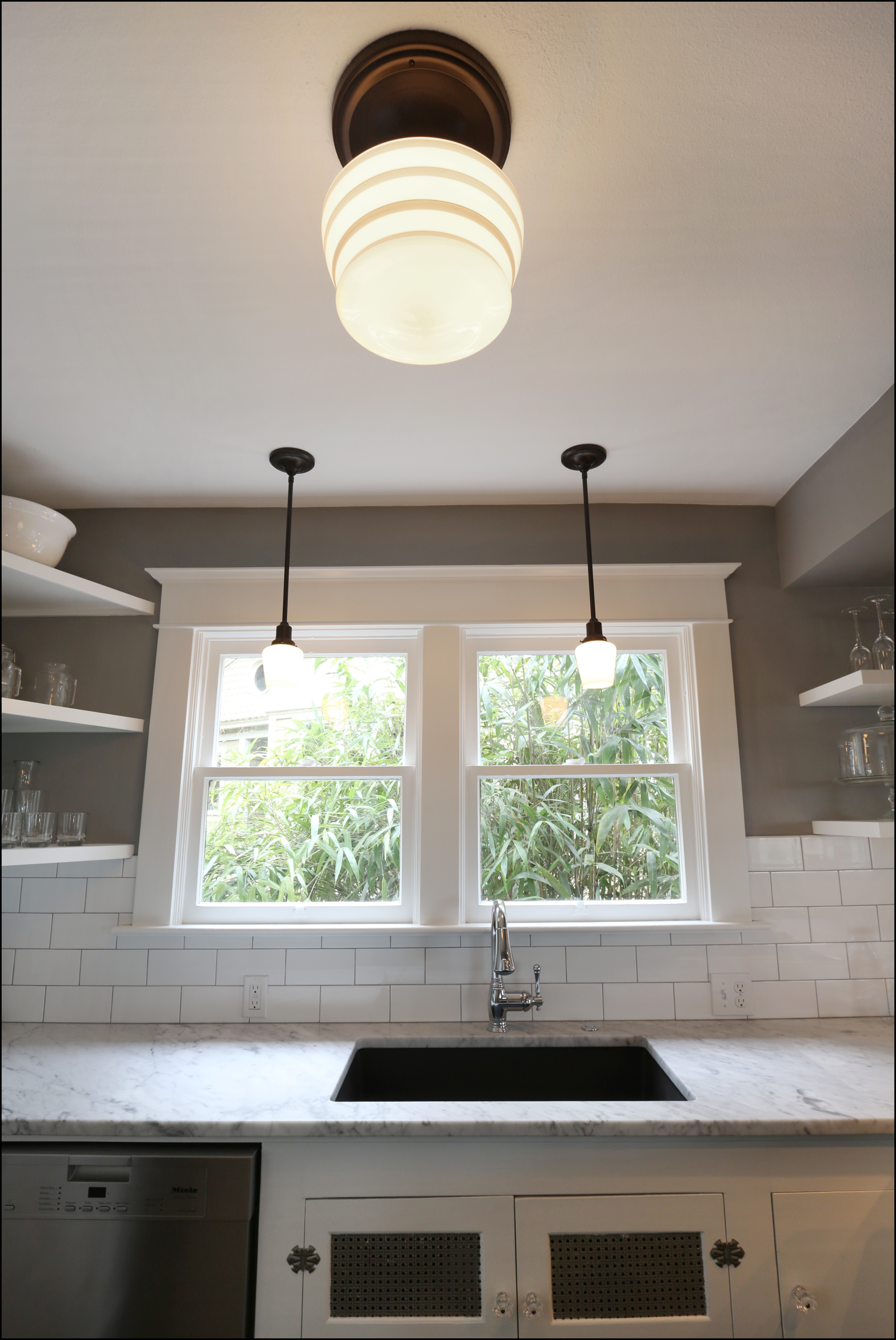charming Schoolhouse Pendant Lighting Kitchen #5: The timeless lighting fixtures from Schoolhouse Electric add grace without distracting from the clean lines of the kitchen. Weu0026#39;re grateful to Master Tech ...
