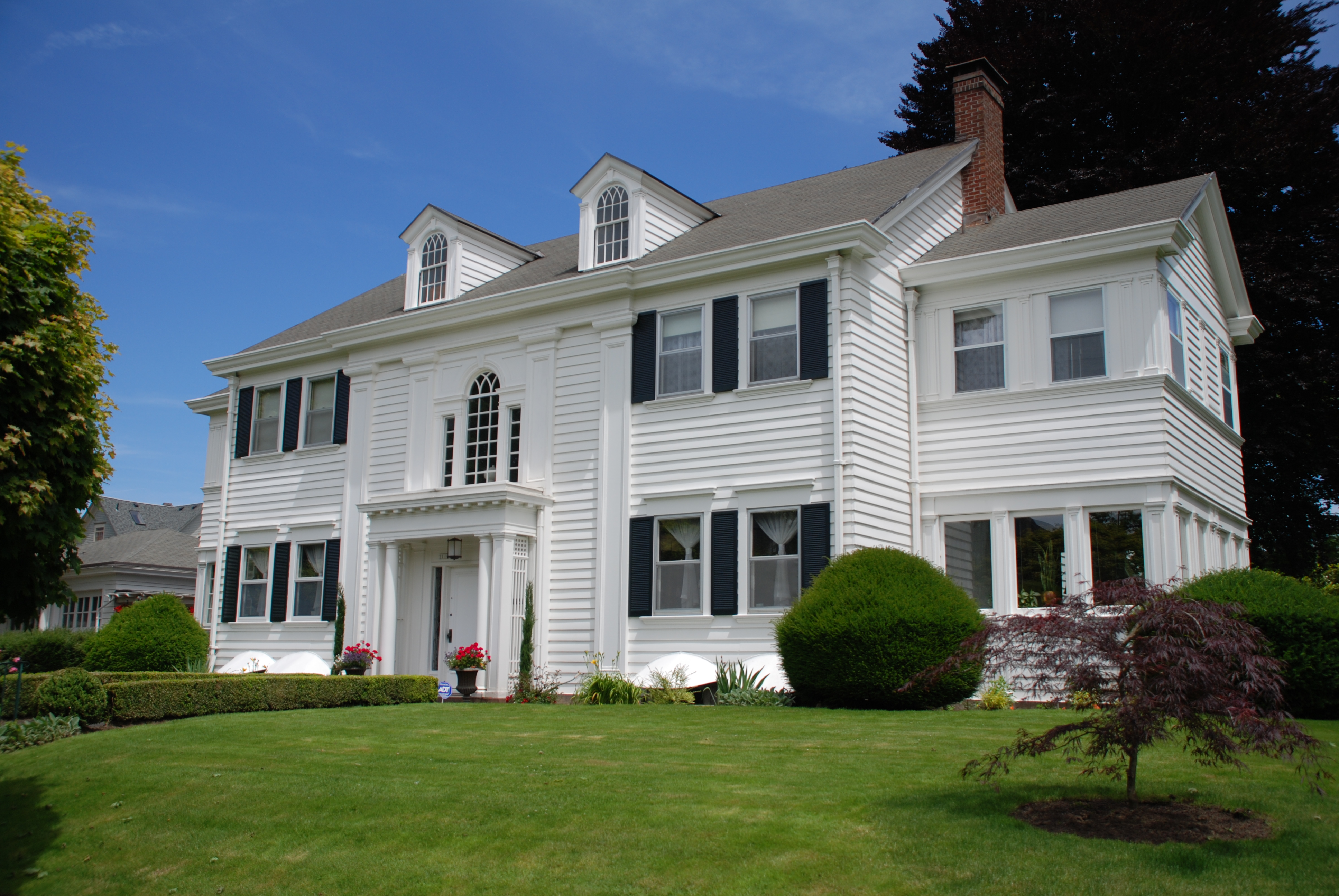 Historic curb appeal inside arciform for Colonial house