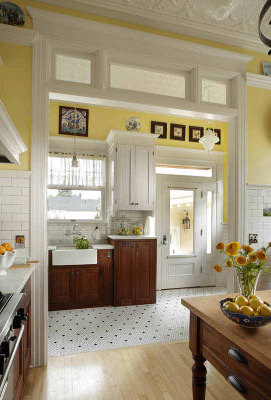 a historic 1913 kitchen with a farmhouse sink mixed painted and stained cabinetry and subway tile throughout  design by anne de wolf  1910 1919 kitchen   inside arciform  rh   insidearciform com