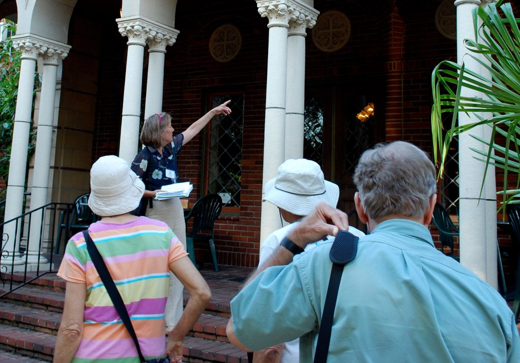 Volunteer Leslie Hutchinson leading a tour in Piedmont