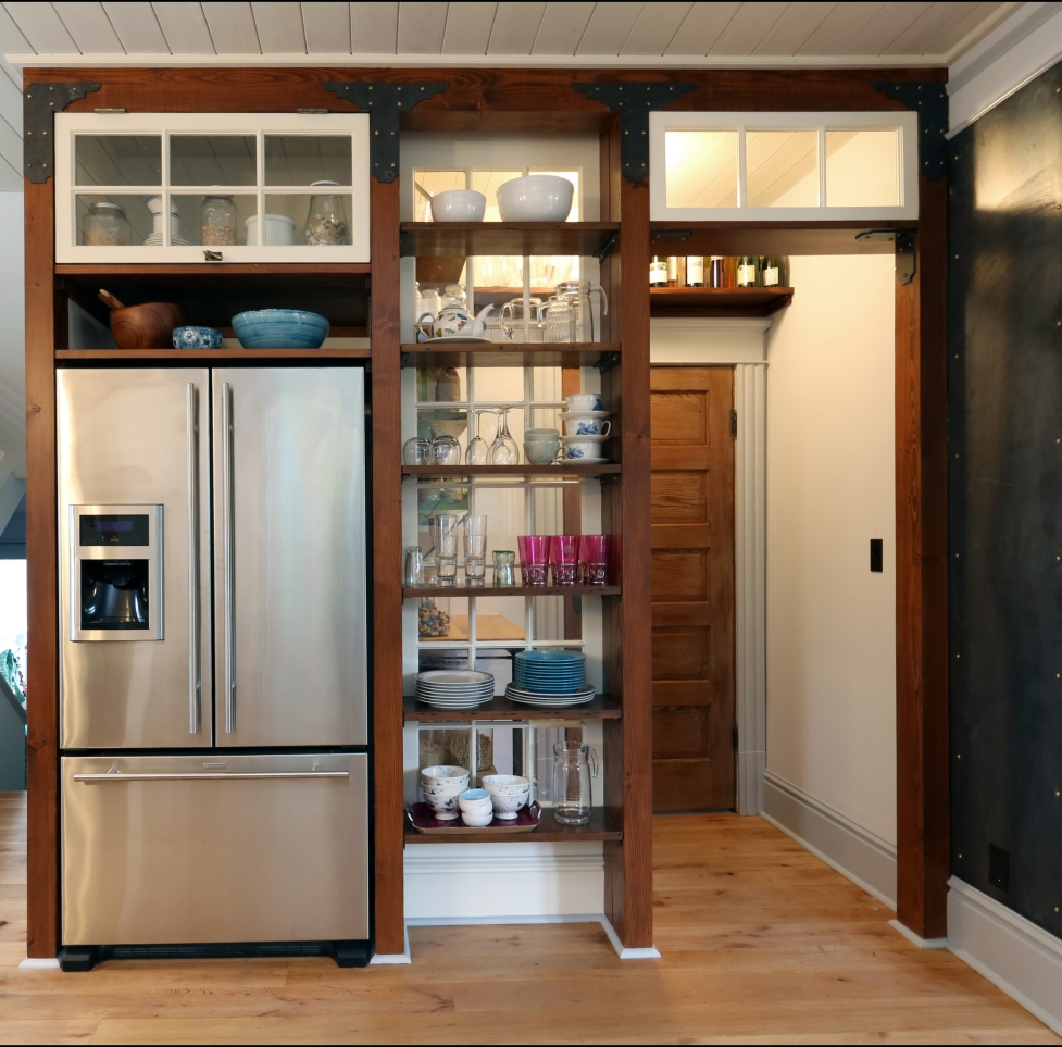 Designed to look like a storefront, this pantry utilizes opening shelving to store colorful and interesting items.