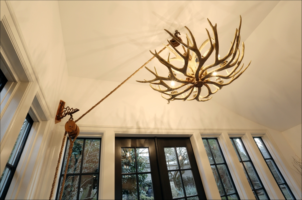This antler chandelier is a focal point in this nook. Design by Kristyn Bester.