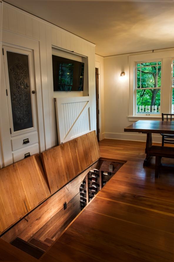 The adventurous spirit of the client inspired the trap door in the new kitchen  floor.